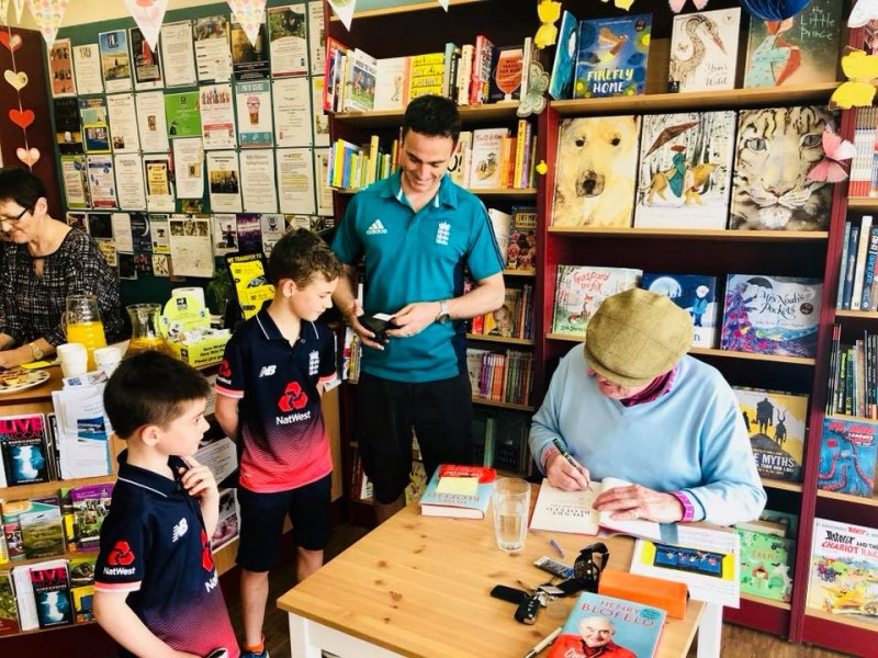 Cricket legend, Henry Blofeld signs books and bats for two young fans!