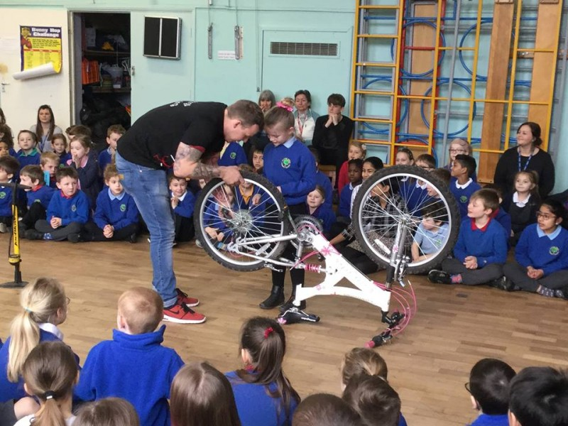 Puncture race with teacher in assembly